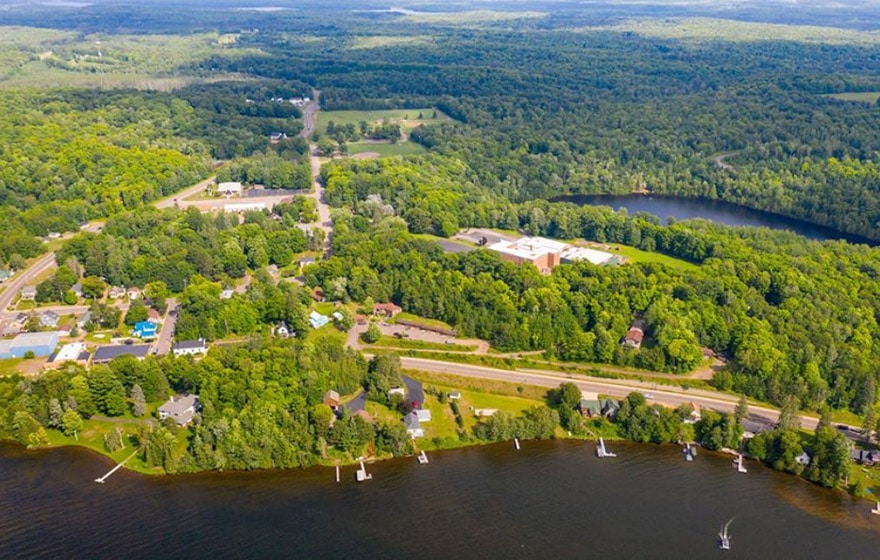 An aerial view of our Wisconsin resort on a lake. you can see that Phelps Lakeview Lodge is a great place to launch from for wilderness adventure!