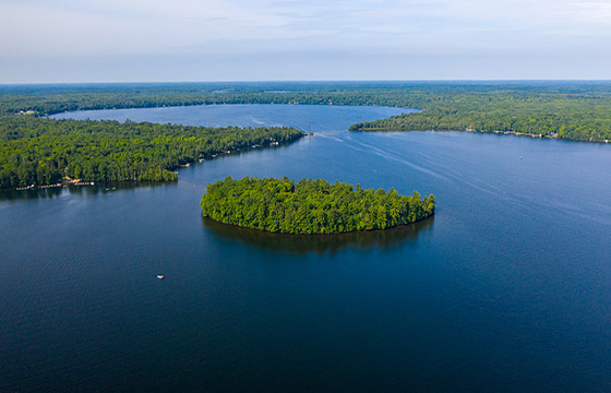 An aerial view of the beauty of North Twin Lake at the height of summer. Our Wisconsin resort on a lake can be your basecamp for any outdoor adventure, from fishing and boating to leaf peeping to ice fishing and snowmobiling.